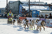 Monica Zappa runs into the chute at the finish line in Nome on Saturday March 21, 2015 during Iditarod 2015.  <br /> <br /> (C) Jeff Schultz/SchultzPhoto.com - ALL RIGHTS RESERVED<br />  DUPLICATION  PROHIBITED  WITHOUT  PERMISSION