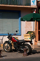 Motor bike with crates with salad lettuce on the back. Collioure. Roussillon. France. Europe.