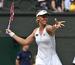 July 2, 2009.Elena Dementieva of Russia, in action during her 6-7, 7-5, 8-6 loss to the USA's Serena Williams in the semi-final of the Wimbledon Championships,at the All England Lawn Tennis Club, Wimbledon, England