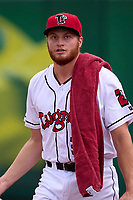 Lansing Lugnuts pitcher Colin Peluse (32) walks to the clubhouse during a weather delay before a game against the West Michigan Whitecaps on August 24, 2021 at Jackson Field in Lansing, Michigan.  (Mike Janes/Four Seam Images)