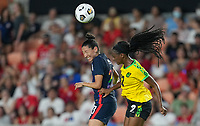 HOUSTON, TX - JUNE 13: Christen Press #23 of the United States and Peyton McNamara #22 of Jamaica battle in the air for a ball during a game between Jamaica and USWNT at BBVA Stadium on June 13, 2021 in Houston, Texas.