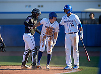 Victory Charter School Knights Lizandro Garcia (21) helps base runner Quinn Blackman (26) up after tagging him out at home along with Sam Felner (13) during a game against the IMG Academy Ascenders on February 28, 2020 at IMG Academy in Bradenton, Florida.  (Mike Janes/Four Seam Images)