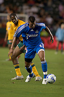 Kansas City defender Jose Burciaga Jr. keeps the ball away from Los Angeles Galaxy midfielder Quavas Kirk. The Los Angeles Galaxy defeated the Kansas City Wizards, 2-1, at the Home Depot Center in Carson, Calif. on September 2, 2006.
