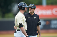 Wake Forest Demon Deacons head coach Tom Walter (16) chats with Shane Muntz (11) during the game against the Miami Hurricanes at David F. Couch Ballpark on May 11, 2019 in  Winston-Salem, North Carolina. The Hurricanes defeated the Demon Deacons 8-4. (Brian Westerholt/Four Seam Images)