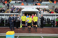 Pictured: Match referee officials exit the tunnel. Tuesday 26 August 2014<br /> Re: Capital One Cup, Swansea City FC v Rotherham at the Liberty Stadium, south Wales