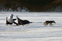 Saturday March 10, 2007   ----   Martin Buser runs on the Yukon River in 35-45 mph winds between Eagle Island and Kaltag on Saturday afternoon.