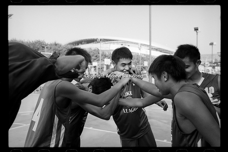 Basketball players of Dongguan Guangming Middle School celebrate winning a match of the China High School Basketball League in Zhuhai, Guangdong province, November 2011.