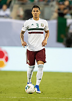 CHARLOTTE, NC - JUNE 23: Carlos Salcedo #3 dribbles the ball during a game between Mexico and Martinique at Bank of America Stadium on June 23, 2019 in Charlotte, North Carolina.