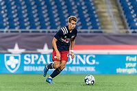 FOXBOROUGH, MA - SEPTEMBER 1: Noel Buck #61 of New Englans Revolution II dribbles at midfield during a game between FC Tucson and New England Revolution II at Gillette Stadium on September 1, 2021 in Foxborough, Massachusetts.