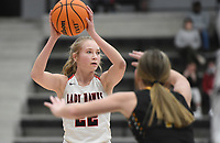 Pea Ridge forward Blakelee Winn (22) looks to pass, Friday, January 8, 2021 during a basketball game at Pea Ridge High School in Pea Ridge. Check out nwaonline.com/210108Daily/ for today's photo gallery. <br /> (NWA Democrat-Gazette/Charlie Kaijo)