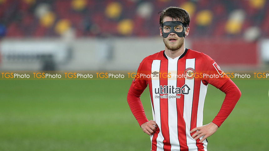 Mathias Jensen of Brentford wearing a mask during Brentford vs Newcastle United, Carabao Cup Football at the Brentford Community Stadium on 22nd December 2020