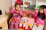 Education Preschool 4 year olds two girls playing together in pretend play area