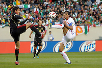 Mexico's Hector Moreno and Costa Rica's Bryan Ruiz look to control a 50-50 ball.  Mexico defeated Costa Rica 4-1 at the 2011 CONCACAF Gold Cup at Soldier Field in Chicago, IL on June 12, 2011.