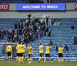 Livingston celebrate to their corner at full time as the Rangers fans leave after witnessing another lacklustre performance
