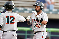 Right fielder Cristopher Cespedes (43) of the Delmarva Shorebirds is greeted by Jean Carmona (12) after scoring a run in a game against the Lynchburg Hillcats on Wednesday, August 11, 2021, at Bank of the James Stadium in Lynchburg, Virginia. (Tom Priddy/Four Seam Images)