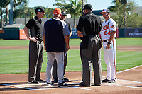 Baltimore Orioles Buck Britton (84) meets with Detroit Tigers manager Ron Gardenhire and umpires John Libka, Will Little, Roberto Ortiz and Alex Tosi before a Grapefruit League Spring Training game against the Detroit Tigers on March 3, 2019 at Ed Smith Stadium in Sarasota, Florida.  Baltimore defeated Detroit 7-5.  (Mike Janes/Four Seam Images)