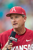 Arkansas Razorbacks head coach Dave Van Horn is interviewed during Game 1 of the NCAA College World Series on June 13, 2015 at TD Ameritrade Park in Omaha, Nebraska. Virginia defeated Arkansas 5-3. (Andrew Woolley/Four Seam Images)