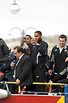 Swansea City Football Club players and staff celebrating their promotion to the Premier League with an opentop bus tour of the city, where thousands of supporters turned out to show their appreciation. Scott Sinclair and Ashley Williams take photos..