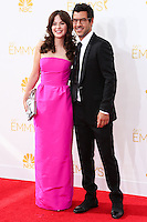 LOS ANGELES, CA, USA - AUGUST 25: Actress Zooey Deschanel and producer Jacob Pechenik arrive at the 66th Annual Primetime Emmy Awards held at Nokia Theatre L.A. Live on August 25, 2014 in Los Angeles, California, United States. (Photo by Celebrity Monitor)