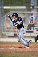 Miami Marlins catcher Alex Jones (64) follows through on a swing during a minor league Spring Training game against the New York Mets on March 26, 2017 at the Roger Dean Stadium Complex in Jupiter, Florida.  (Mike Janes/Four Seam Images)