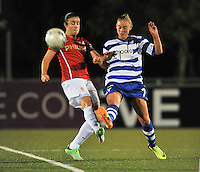 20130906 - OOSTAKKER , BELGIUM : Gent's Margaux Van Ackere pictured with PSV Manon Van Den Boogaard (left) during the female soccer match between AA Gent Ladies  and PSV / FC Eindhoven Dames , of the third matchday in the BENELEAGUE competition. Friday 06 th September 2013. PHOTO DAVID CATRY