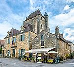 La Place de la Halle of the village of Domme, in Périgord Noir, with the Office of Tourisme and the restaurant La Poivrière.