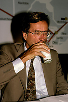 Montreal (QC)CANADA - 1988File Photo<br /> Quebec Premier and<br /> Liberal Provincial Leader Robert Bourassa<br /> with his traditional glass of milk during a press conference.