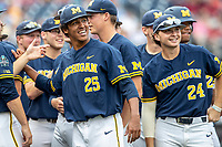 Michigan Wolverines pitcher Isaiah Paige (25) laughs with his teammates before Game 6 of the NCAA College World Series against the Florida State Seminoles on June 17, 2019 at TD Ameritrade Park in Omaha, Nebraska. Michigan defeated Florida State 2-0. (Andrew Woolley/Four Seam Images)