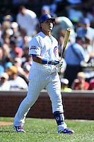 Chicago Cubs second baseman Javier Baez (9) walks back to the dugout after striking out during a game against the Milwaukee Brewers on August 14, 2014 at Wrigley Field in Chicago, Illinois.  Milwaukee defeated Chicago 6-2.  (Mike Janes/Four Seam Images)