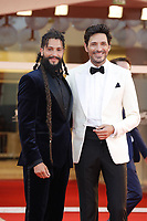 """VENICE, ITALY - SEPTEMBER 10: Rawkan Bin Bella and Andrés Velencoso  on the red carpet for the movie """"Un Autre Monde"""" during the 78th Venice International Film Festival on September 10, 2021 in Venice, Italy.<br /> CAP/GOL<br /> ©GOL/Capital Pictures"""