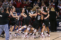 31 March 2008: Ashley Cimino, Jillian Harmon, Kayla Pedersen, JJ Hones, Jayne Appel, Jeanette Pohlen and Candice Wiggins celebrate after Stanford's 98-87 win over the University of Maryland in the elite eight game of the NCAA Division 1 Women's Basketball Championship in Spokane, WA.