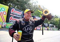 May 17, 2015; Commerce, GA, USA; NHRA funny car driver Tim Wilkerson celebrates after winning the Southern Nationals at Atlanta Dragway. Mandatory Credit: Mark J. Rebilas-USA TODAY Sports