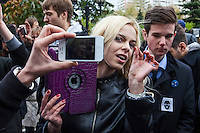 Moscow, Russia, 01/10/2012..Pussy Riot supporters argue with anti Pussy Riot protesters filming them on mobile phones outside Moscow City Court. Supporters and opponents of band members Maria Alyokhina, Yekaterina Samutsevich and Nadezhda Tolokonnikova demonstrated outside the court as the three appealed against their two-year jail sentence for their performance in the Christ The Saviour Cathedral. The appeal was postponed until October 10th after Samutsevich fired her lawyer.