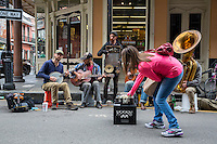 French Quarter, New Orleans, Louisiana.  Woman Making a Donation to a Group of Street Performing Musicians.
