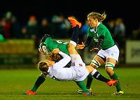 27.02.2015. Ashbourne Rugby Club, Ireland. Womens 6-Nations international. Ireland versus England. Hannah Gallagher ( England) tackles Jenny Murphy (Ireland).