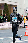 Feb. 27, 2010 - Tokyo, Japan - A runner wearing a Spiderman outfit races through the Ginza district part of town during the Tokyo Marathon. Some 36,000 runners participated in this fifth edition of the Tokyo Marathon.
