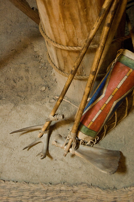 Mandan tools were made from animal antlers and bones such as this deer antler rake and bison scapula bone hoe on display inside a earth lodge at the Knife River Indian Village, North Dakota
