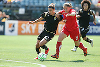 Christine Sinclair (12) tries to steal the ball from Cat Whitehill (4). FC Gold Pride defeated Washington Freedom 3-2 at Buck Shaw Stadium in Santa Clara, California on August 1, 2009.