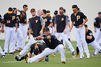 Pittsburgh Pirates Jose Osuna and teammates stretch during the teams first Spring Training practice on February 18, 2019 at Pirate City in Bradenton, Florida.  (Mike Janes/Four Seam Images)