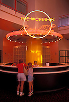 World of Coca-Cola, Atlanta, GA, Georgia, Mother and eight year old daughter purchasing tickets at the ticket counter at the World of Coca-Cola in downtown Atlanta.