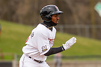 Wisconsin Timber Rattlers outfielder Troy Stokes (15) races to first during a Midwest League game against the Beloit Snappers on April 10th, 2016 at Fox Cities Stadium in Appleton, Wisconsin.  Wisconsin defeated Beloit  4-2. (Brad Krause/Four Seam Images)