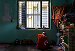 18 JUNE 2015, Mandalay, Myanmar:  A young monk reads in the corner of 969 activist Monk Wirathu's  quarters in the Masoeyein Monastery in Mandalay, Myanmar. Picture Graham Crouch/The Australian Magazine