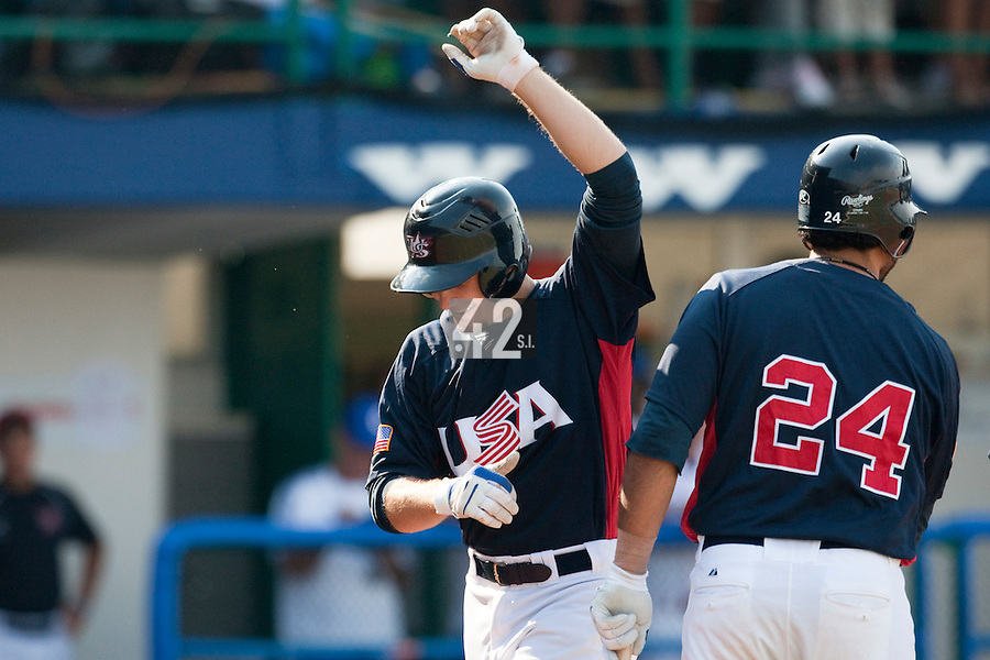 27 September 2009: Lucas May of Team USA celebrates after hitting a three run home run during the 2009 Baseball World Cup gold medal game won 10-5 by Team USA over Cuba, in Nettuno, Italy.