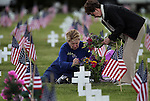 Carol Simnad, seated, and her mom Irene Risky place flowers on her father Daniel Riskey's grave at Lone Mountain Cemetery in Carson City, Nev., on Monday, May 27, 2013. The pair were on hand for the annual Memorial Day Ceremony, honoring veterans who died for their country.  .Photo by Cathleen Allison