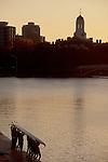 Charles River, Cambridge, Massachusetts, Harvard University, Harvard University women rowers launching eight oared racing shell,