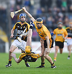 Shane O Brien of Clonlara in action against Stan Lineen and Niall Deasy of Ballyea  during their senior county final replay at Cusack Park. Photograph by John Kelly.
