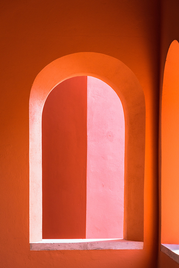 Interplay of waning sunlight on nested arches.
