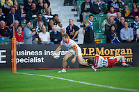 20120803 Copyright onEdition 2012©.Free for editorial use image, please credit: onEdition..James Short of Saracens runs through the tackle of Ian Clark of Gloucester Rugby to score  at The Recreation Ground, Bath in the Final round of The J.P. Morgan Asset Management Premiership Rugby 7s Series...The J.P. Morgan Asset Management Premiership Rugby 7s Series kicked off again for the third season on Friday 13th July at The Stoop, Twickenham with Pool B being played at Edgeley Park, Stockport on Friday, 20th July, Pool C at Kingsholm Gloucester on Thursday, 26th July and the Final being played at The Recreation Ground, Bath on Friday 3rd August. The innovative tournament, which involves all 12 Premiership Rugby clubs, offers a fantastic platform for some of the country's finest young athletes to be exposed to the excitement, pressures and skills required to compete at an elite level...The 12 Premiership Rugby clubs are divided into three groups for the tournament, with the winner and runner up of each regional event going through to the Final. There are six games each evening, with each match consisting of two 7 minute halves with a 2 minute break at half time...For additional images please go to: http://www.w-w-i.com/jp_morgan_premiership_sevens/..For press contacts contact: Beth Begg at brandRapport on D: +44 (0)20 7932 5813 M: +44 (0)7900 88231 E: BBegg@brand-rapport.com..If you require a higher resolution image or you have any other onEdition photographic enquiries, please contact onEdition on 0845 900 2 900 or email info@onEdition.com.This image is copyright the onEdition 2012©..This image has been supplied by onEdition and must be credited onEdition. The author is asserting his full Moral rights in relation to the publication of this image. Rights for onward transmission of any image or file is not granted or implied. Changing or deleting Copyright information is illegal as specified in the Copyright, Design and Patents Act 1988. If you are in any way unsure of yo
