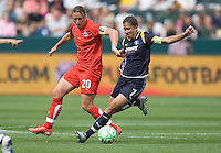 LA Sol's Shannon Boxx (7) tries to get past Washington Freedom's Abby Wambach (20) during the WPS season opening game at the Home Depot Center, Sunday, March 29, 2009. The LA Sol won 2-0.