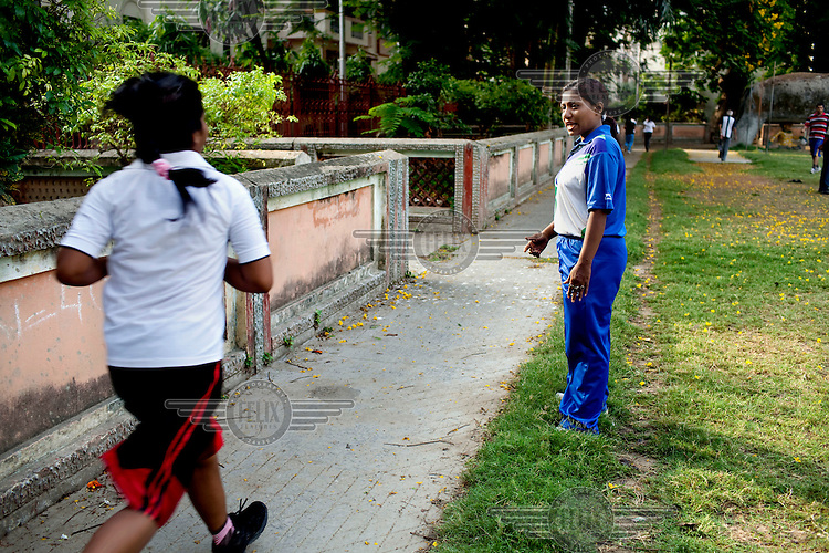 Razia Shabnam (in blue) conducts a boxing training session with a group of girls in a park in Basduni, Tolly Gunge. 28 year old Razia Shabnam was one of the first women boxers in Kolkata and also the first woman in her community to go to college. She is now a coach and one of only three international female boxing referees in India.